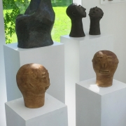 7 heads on plinths