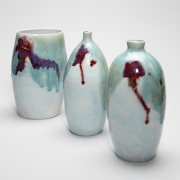 11. Matthew Booth- Two bottles and a vase with fluxing glazes